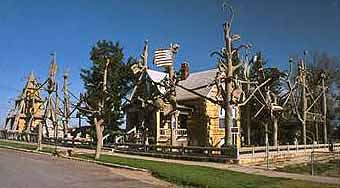 the garden of eden is a mind boggling half acre of concrete sculpture and architecture that towers over this sleepy community of 600 like the proverbial - Garden Of Eden Kansas